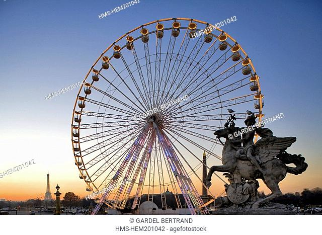 France, Paris, Place de la Concorde, one of the Marly Horses, the Great Wheel and the Eiffel Tower in the background