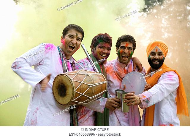 Men celebrating Holi