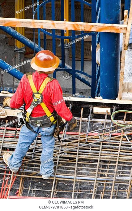 High angle view of a construction worker standing at a construction site