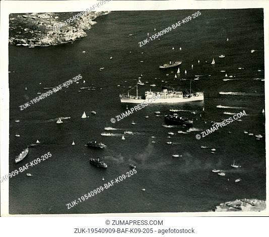 Sep. 09, 1954 - Royal Tour of Australia. The 'Gothic' Arrives in Sydney Harbour. Keystone Photo Shows: Surrounded by dozens of small craft and escorting vessels...