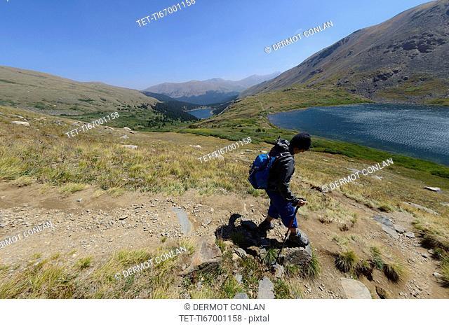 Woman hiking on Silver Dollar Trail in Colorado