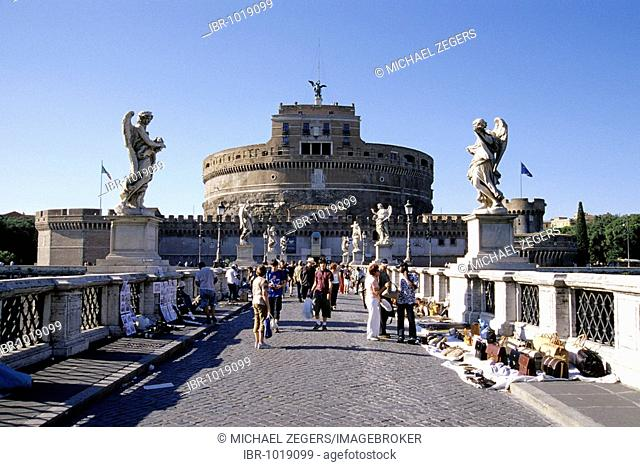 Tourists on the Ponte Sant Angelo Bridge crossing the Tiber River, decorated with sculptures of angels by Bernini, in the back Castel Sant Angeo Castle, Rome