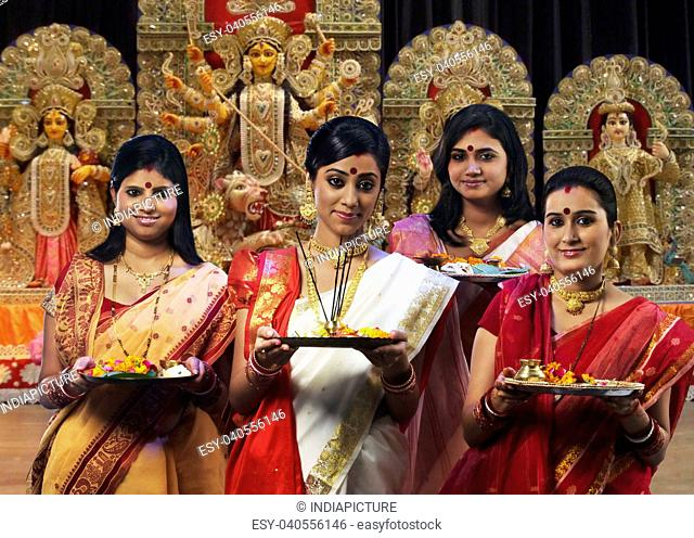 Bengali women celebrating Durga puja