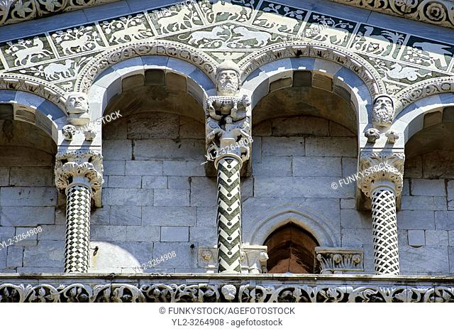 Close up of the Arcades and and columns of St Michele of the 13th century Romanesque facade of the San Michele in Foro, a Roman Catholic basilica church in...