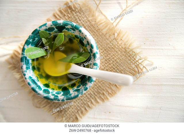 Presentation of small container of extra virgin olive oil