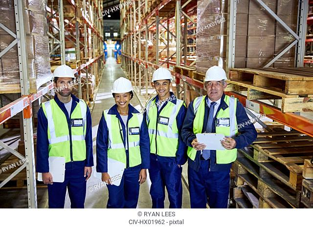 Portrait confident manager and workers in distribution warehouse