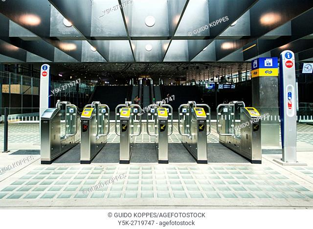 Delft, Netherlands. Gates for payment into the newly (2016) build Delft Railway Station