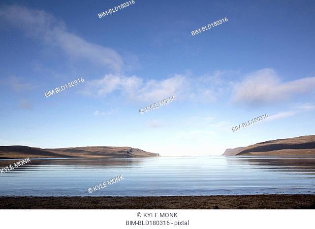 Hills and remote ocean horizon