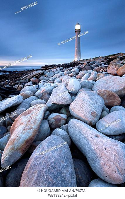 Wide angle landscape photo of a lighthouse on rocks. Kommetjie, Cape Town, South Africa