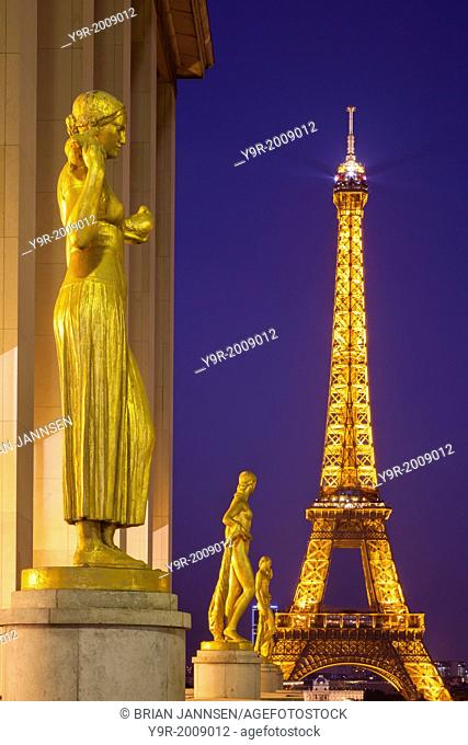 Golden statues at Palais de Chaillot with the Eiffel Tower beyond, Paris France