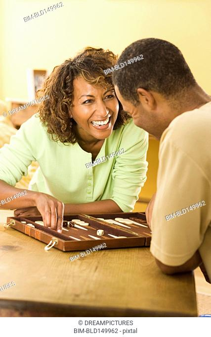 Couple playing backgammon together