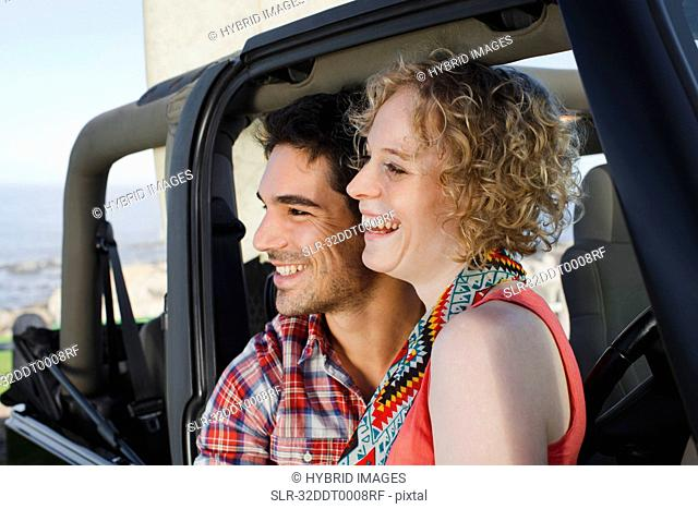 Couple smiling in jeep