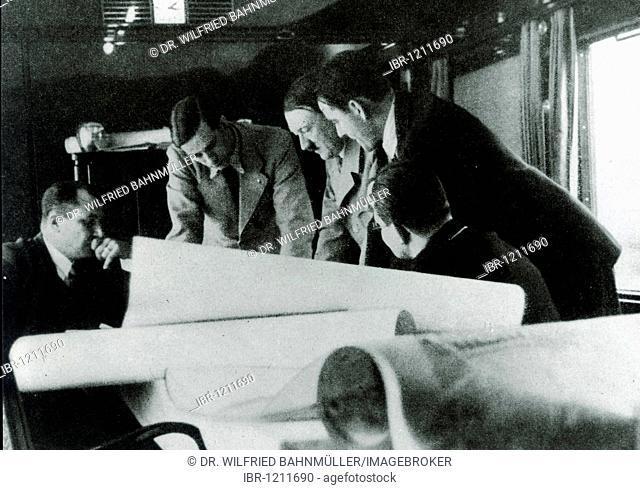 Reichsleiter Bouhler, Prof. Speer, Adolf Hitler, Dr. Brand, Reichsleiter Bormann during a meeting in the special train of the Fuehrer