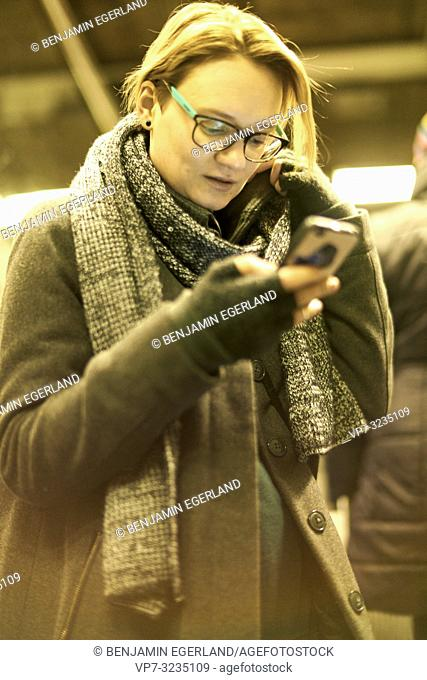 woman in city using smartphone, in Munich, Germany