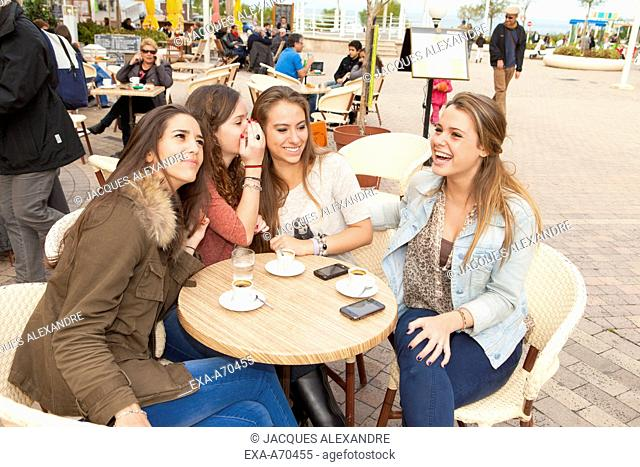 group of girls sitting in coffee shop