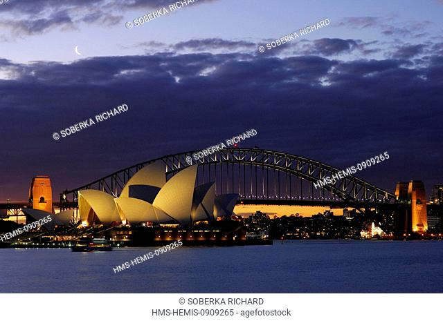 Australia, New South Wales, Sydney, Opera House designed by architect Jon Urtzon listed as World Heritage by UNESCO and Harbour Bridge by night