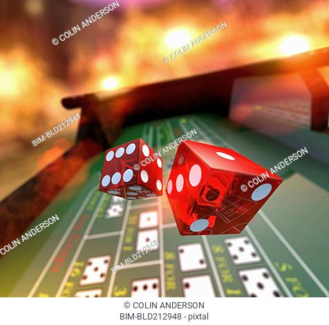 Dice falling onto craps table