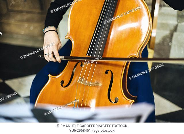 Woman playing cello in wedding ceremony