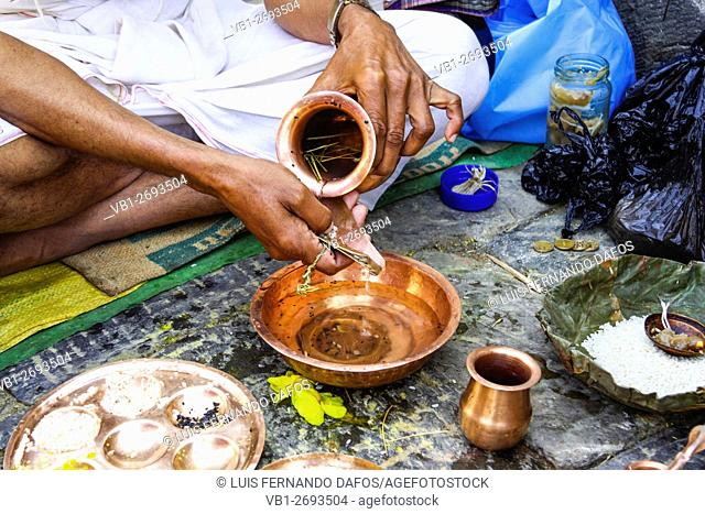 Close up of brahmin hands performing puja Pashupatinath Nepal