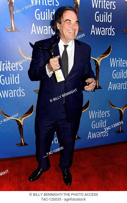 Screenwriter/Director Oliver Stone poses with the Laurel Award for Screenwriting Achievement during the 2017 Writers Guild Awards L.A