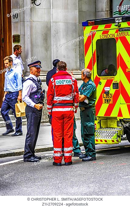 A Policeman, Rapid Response doctor and paramedics discuss an emergency call out in central London