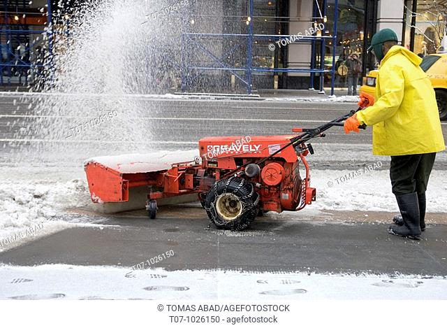 Public Worker plowing snow on 5th Avenue and 42nd Street, New York City, February 2010