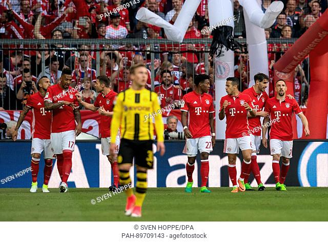 Munich's Franck Ribery (r) celebrates his 1:0 goal with the team during the German Bundesliga soccer match between Bayern Munich and Borussia Dortmund at the...