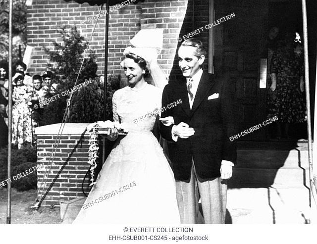 Mr. & Mrs. Clifton Daniel leave the Trinity Episcopal Church after their wedding. She was Margaret Truman, only child of former Pres