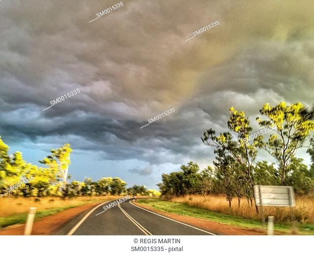 Rod under a storm, in the Australian Outback, with a speed effect due to being photographed from a moving car