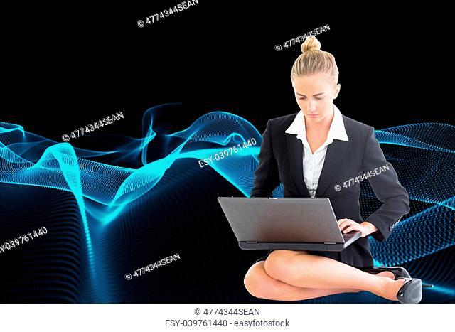 Composite image of blonde businesswoman using laptop