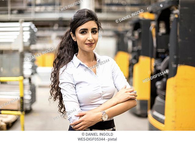 Portrait of confident woman in factory shop floor