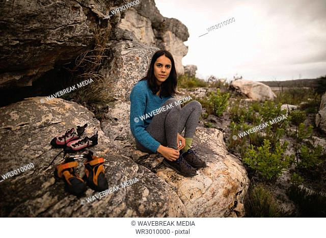 Confident woman wearing sports shoes