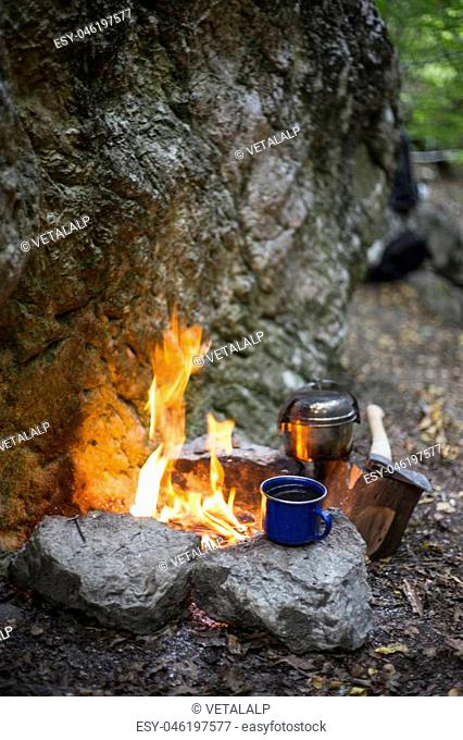 Cooking breakfast on a campfire at a summer camp