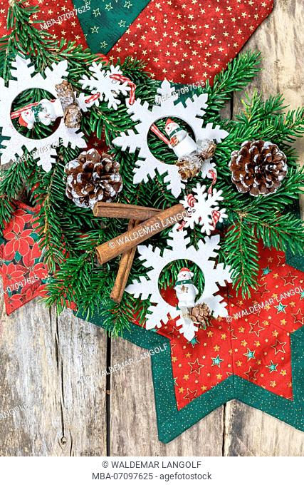 Christmas decoration, star made of fabric, branch