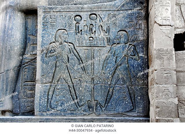 Luxor, Egypt. Temple of Luxor: relief on the base of the giant statue of the pharaoh Ramses II (1303-1212 b.C.)