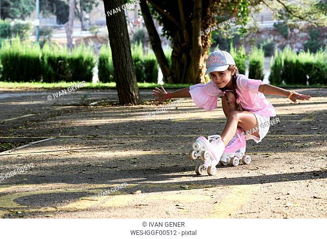 Little girl skating and doing tricks