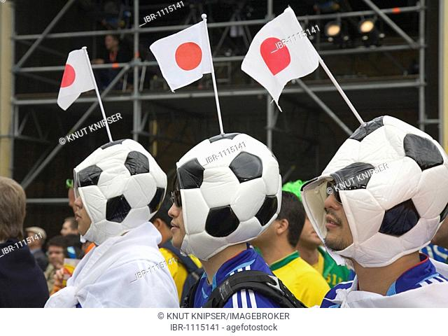 Three Japanese soccer fans wearing hats shaped like footballs, Football World Cup 2006, Dortmund, North Rhine-Westphalia, Germany