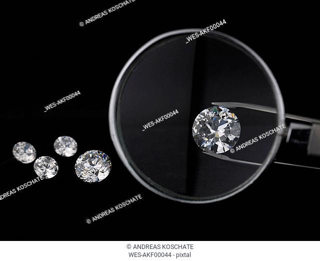 Magnifying glass over diamond