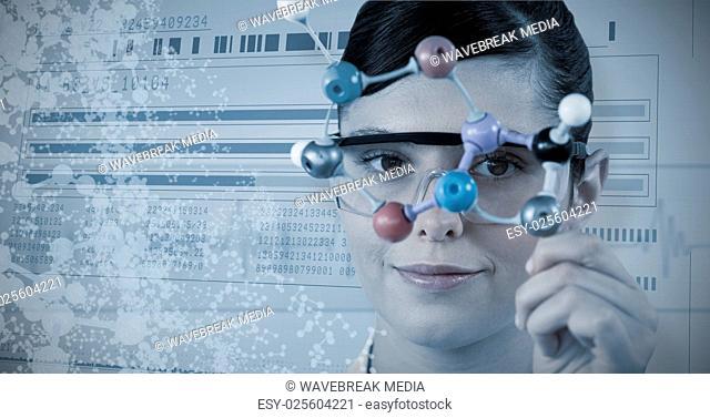 Composite image of portrait of scientist holding molecular model