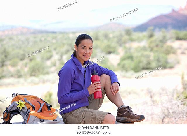 Portrait of mature female hiker with water bottle, Sedona, Arizona, USA