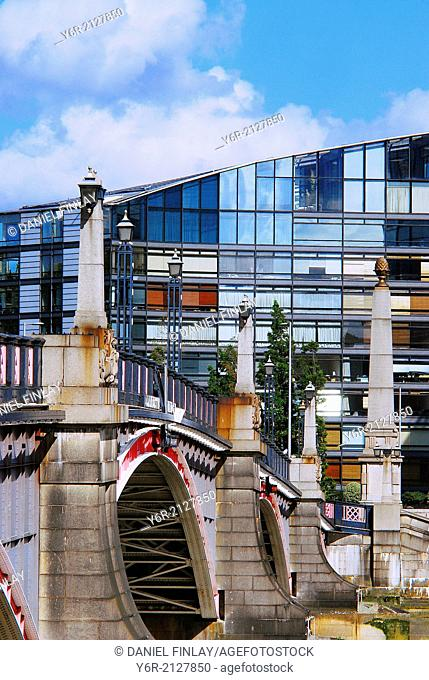 Lambeth Bridge over the River Thames and Lambeth office building in the heart of London, England, on a Summers day