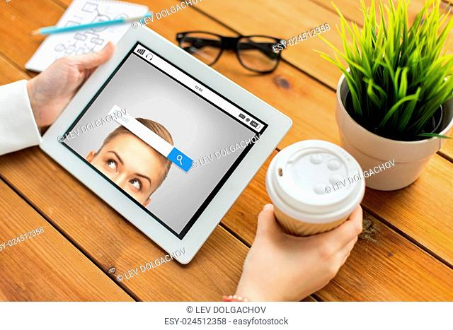 business, education, technology, people and advertisement concept - close up of woman with internet browser search bar on tablet pc computer screen and coffee...