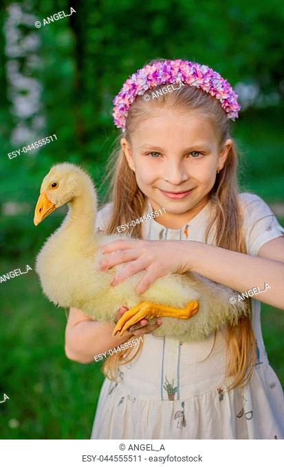 Closeup portrait girl with duckling holding
