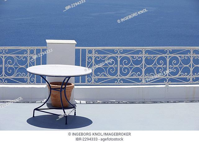 Round table, railing, ocean, Fira, Santorini, Greece, Europe, PublicGround