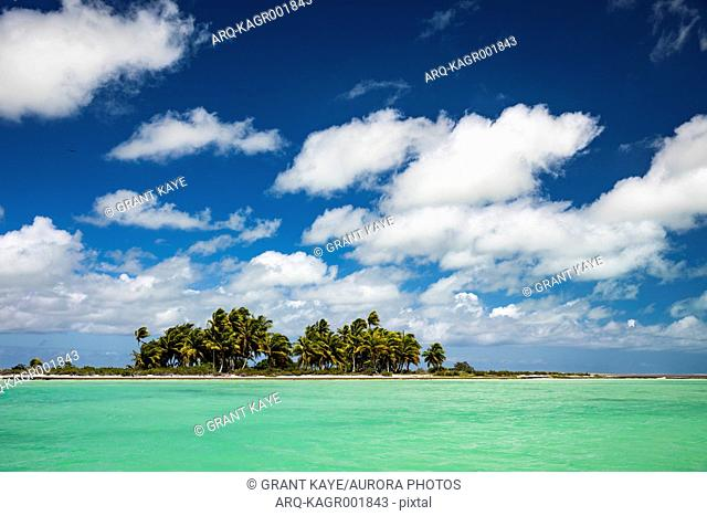 Large clouds over Christmas Island coastline during sunny weather, Kiribati