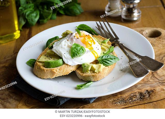 Avocado and poached egg on Rye with basil