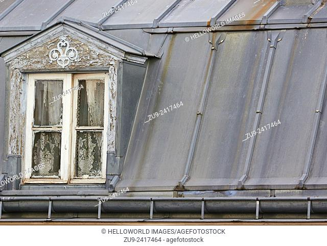 Attic window in rooftop room, Paris, France, Europe