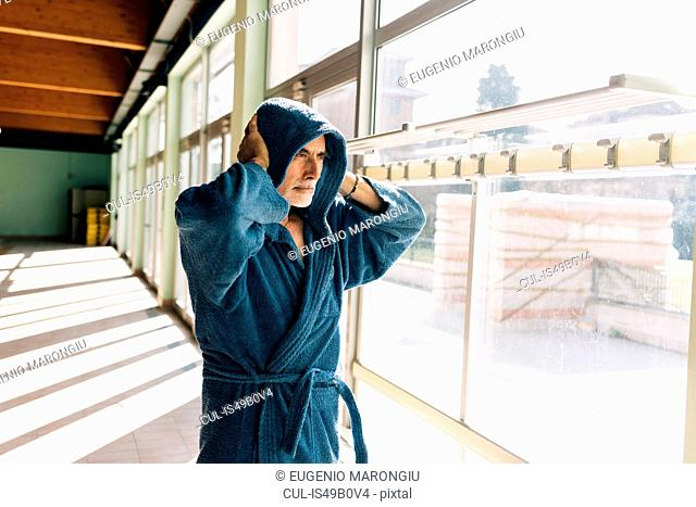 Senior man in hooded bath robe
