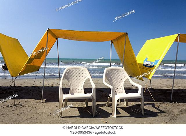 Parasols and chairs at the sandy beach, Cartagena, Colombia