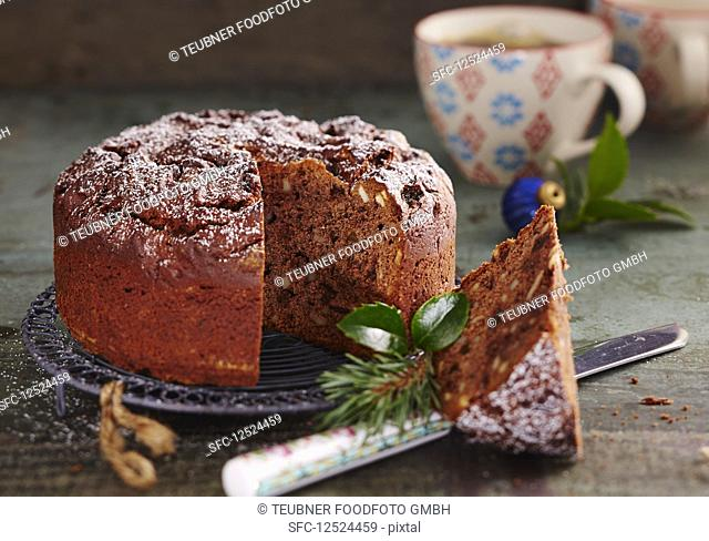 A small chocolate honey cake with almonds and raisins for Christmas